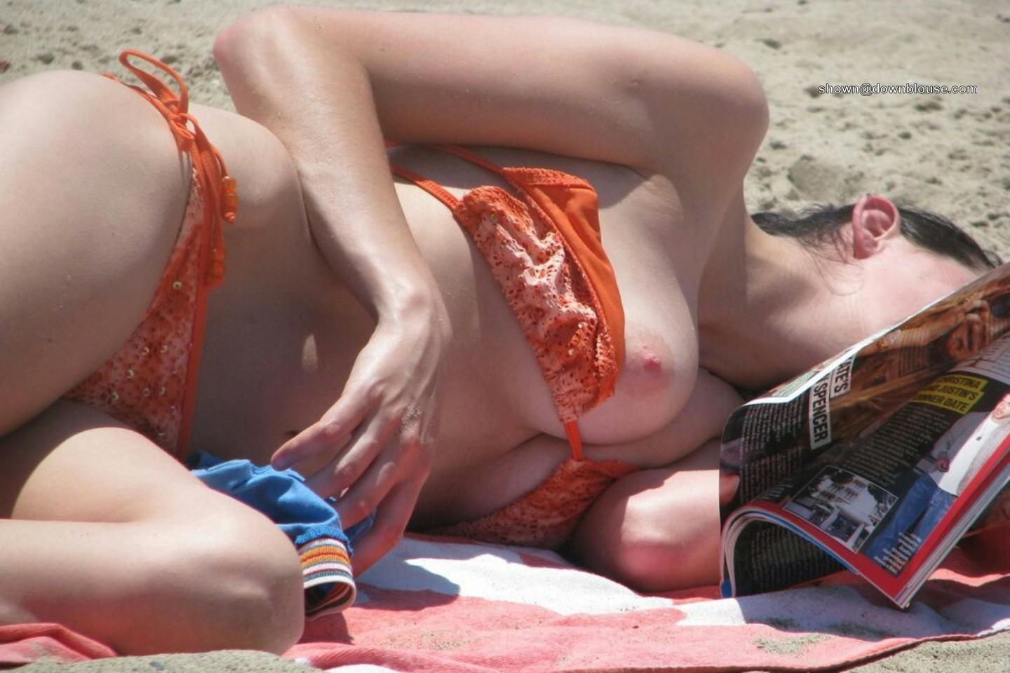 Bikini malfunction on the beach High quality images in more than 40 categories!